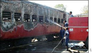 Firefighters hosing down the train carriages
