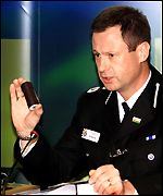Deputy Chief Constable Brereton holds a plastic bullet