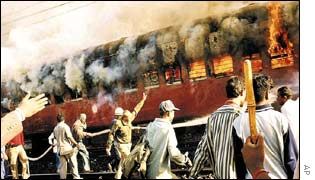 Train burns near Godhra, Gujarat, after at was stopped and set alight in an attack by Muslims
