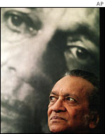 Ravi Shankar poses with his poster