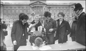 The Sex Pistols sign a record contract in the shadows of Buckihgam Palace