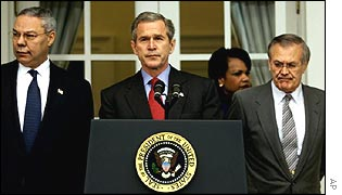 President Bush (centre) flanked by Colin Powell (l) and Donald Rumsfeld (r)