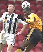 Lee Bullen is beaten this time by Livi's Marvin Andrews