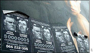 Wanted posters for Karadzic (right) and fellow suspect Ratko Mladic