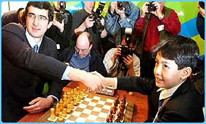 Vladimir Kramnik shakes hands with 11-year-old opponent David Howell