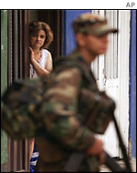 Colombian woman watches a government soldier