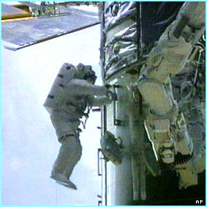 British astronaut Michael Foale carries out repairs on the Hubble Space Telescope in 1999