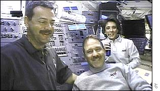 Commander Scott Altman, left, with astronauts John Grunsfeld and Nancy Currie , AP