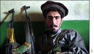 Pro-US Afghan fighter rests near Gardez