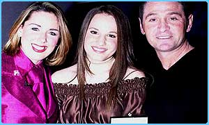 Jessica Garlick with presenter Claire Sweeney and Martin Baylay, who wrote her song