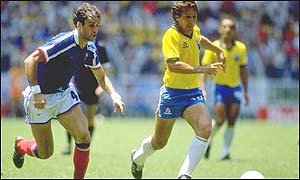Zico gets away  from France's Patrick Batiston