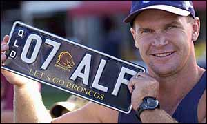 Allan Langer with a number plate presented to him at a fans day