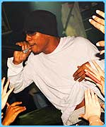 Asher-D performing at a gig