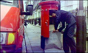 Mailman picking up post from a letter-box