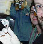 A scientists holding a rock from under the sea, BBC