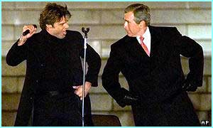 American president George W Bush boogies with Ricky Martin - cool friends, uncool dancing