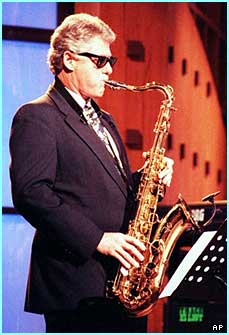 Now that's cool! - Ex-president Bill Clinton in shades and playing a sax - shame he's retired now