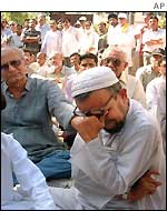 A Muslim man cries during a peace meeting in Ahmedabad