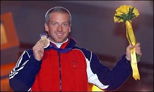 Alain Baxter celebrates on the podium with his bronze medal