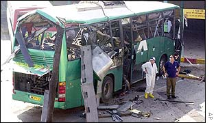 Wrecked bus after Palestinian militant's attack