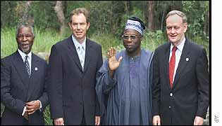 South Africa's Thabo Mbeki, Britain's Tony Blair, Nigeria's Olusegun Obasanjo, Canada's Jean Chrétien