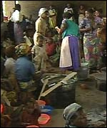 People receiving help in a church hall