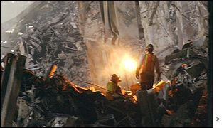 Workers clear the site of the World Trade Center, AP