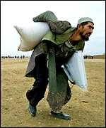 Man carrying sack of wheat