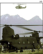 US Army soldiers board a CH-47 Chinook helicopter from Bagram