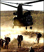A US helicopter drops off troops