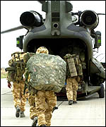 Royal Marines board a Chinook helicopter