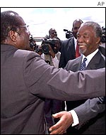 Robert Mugabe and Thabo Mbeki