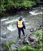Rescuer walking in River Ribble