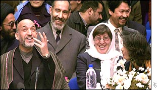 Hamid Karzai (left) at International Women's Day in Kabul