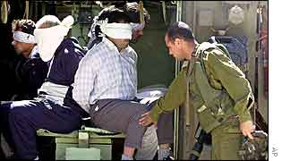 Blindfolded Palestinians in Israeli armoured vehicle in Beit Jala, West Bank