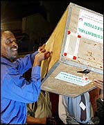 Voting staff holding sealed ballot boxes