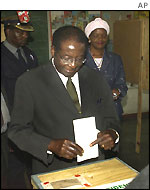 President Mugabe voting in Harare