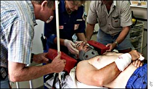 Lesie de Jager, 34, a white farmer from Lions Den, attacked 06 March 2002 on his farm by settlers, arrives at a hospital in Harare