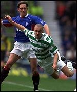 Larsson goes down under Ricksen's challenge