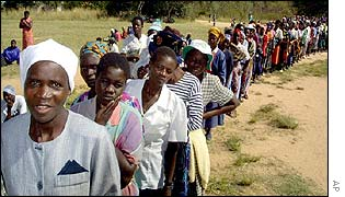 Zimbabweans queue to cast their votes in rural Magunje, west of Harare