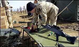 US soldier cleans weapon at Bagram air base, Afghanistan