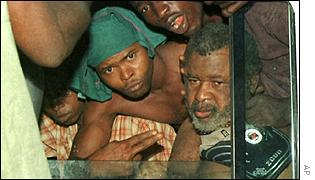 Sankoh (r) with his civilian captors shortly before he was turned in to authorities in Sierra Leone