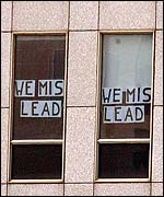 Protest banners posted on the windows of the Rembrandt Tower