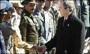 US President George W Bush shakes hands with military leaders from foreign countries