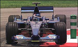 Gaston Mazzazane in a Prost at the 2001 Malaysian Grand Prix