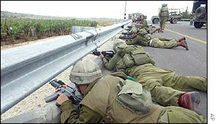 Israeli soldiers exchange fire with the gunmen