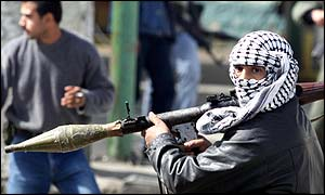 A masked Palestinian holds an anti-tank rocket propelled grenade (RPG) in Ramallah