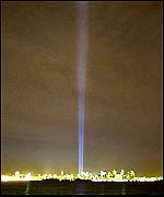 Two beams of light pierce the sky above Manhattan from near the site of the World Trade Center