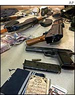Guns and paraphenalia recovered from the dead men