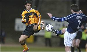 Massimilano Caputo challenges Dundee's Barry Smith